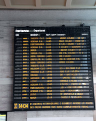 transport timetable at a rail station in Italy