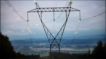 Moving electricity on electric pole.