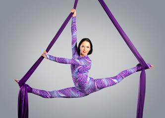 Beautiful dancer on aerial silk, aerial contortion, aerial ribbo