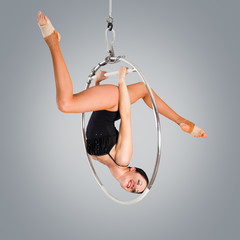 Plastic beautiful girl gymnast on acrobatic circus ring in flesh