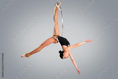 Fototapeta Plastic beautiful girl gymnast on acrobatic circus ring in flesh