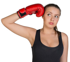 Woman holding boxing glove at her temple