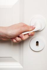 Female hand on door handle
