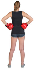 Woman in boxing gloves standing akimbo
