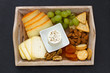 cheese platter on black background
