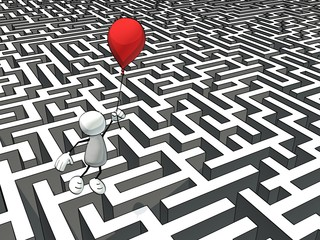 little sketchy man escaping a maze with a red balloon