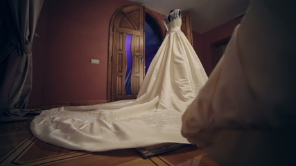 DOLLY MOTION: Wedding dress with long train on a mannequin