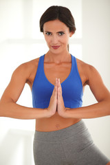Beautiful brunette doing yoga for relaxation
