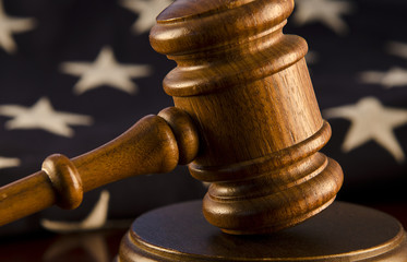 Wooden gavel with flag background