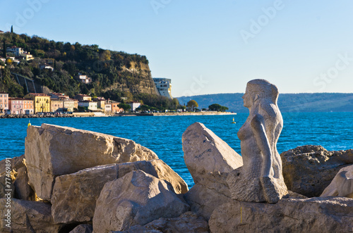 Mermaid sculpture carved out of rocks at Piran harbor, Istria Poster