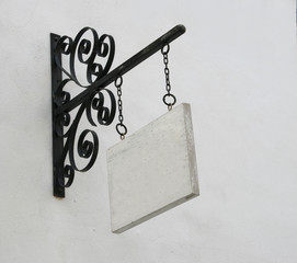 Wood sign hanging on steal