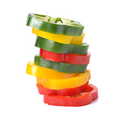Sliced red yellow green pepper isolated on white