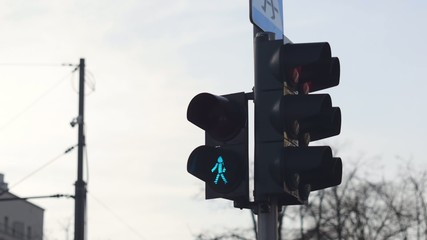 Pedestrian lights changing from green to red.