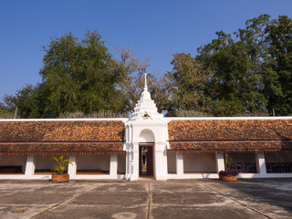 Northern Thai art temple wall under blue sky