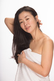 Young Asian woman after shower skincare haircare poster