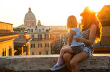 Mother and baby girl sitting on street  in Rome - 77473497