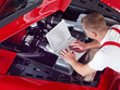Leinwanddruck Bild - Mechanic is tuning and checking the engine