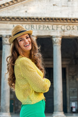 Portrait of smiling young woman in front of pantheon in rome