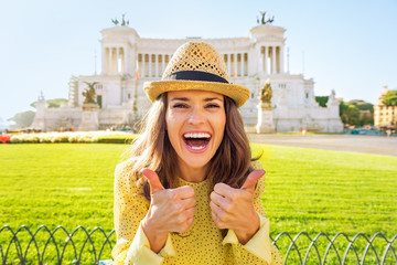 Portrait of happy woman showing thumbs up on piazza venezia