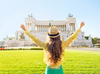 Young woman on piazza venezia in rome, italy rejoicing