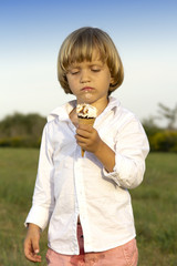 Young cute boy eating a tasty ice cream