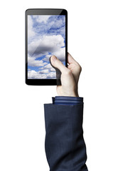 Hand holding a digital tablet with clouds on the screen