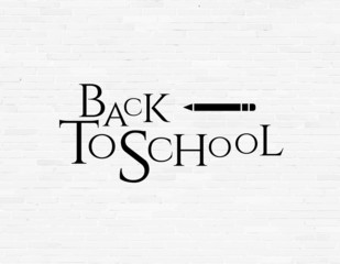 Back to school phrase on white brick wall