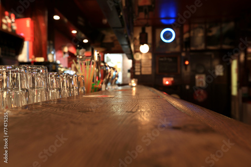 Bar, old wooden rack with glasses in the pub