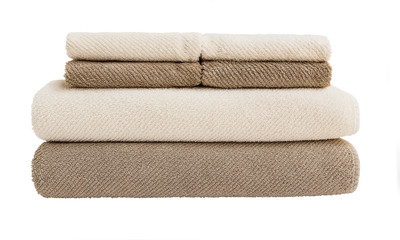 Big and small bath towels in stack  isolated over white
