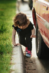 little girl playing in the street on road