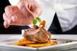 Leinwandbild Motiv Chef in hotel or restaurant kitchen cooking, only hands.