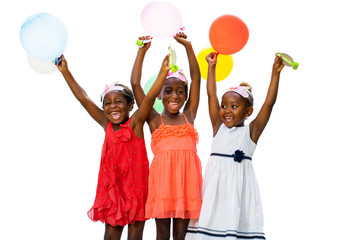 Three african youngsters having fun with balloons at party.