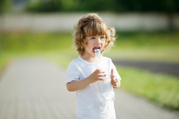 little girl drinking clean water from plastic bottle