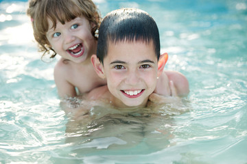 brother and sister in the pool