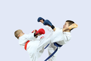 Combat Karate fight two athletes