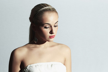 sad bride.Beautiful woman in white dress.Fashion girl.red lips