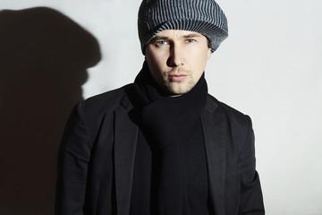 Fashionable Handsome Man in scarf.European Boy in hat.spring