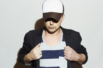 Fashionable Handsome Man in Cap.Stylish Boy in tracker hat
