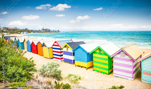 Foto op Canvas Strand Beautiful Bathing houses on white sandy beach at Brighton beach,