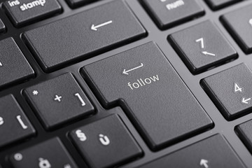 """Computer keyboard with """"Follow"""" button, focus on enter button"""