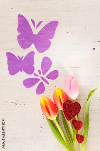 canvas print picture Tulpen, Schmetterlinge und Herzchen als Frühjahrsboten