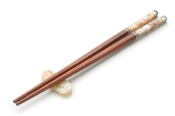 Wooden chopsticks on chopstick rest