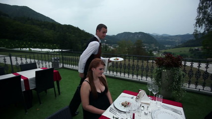 waiter served dinner to lovely couple on date