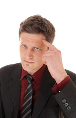Man with finger on forehead.