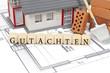 Leinwanddruck Bild - Bauplan mit Ziegelstein und Haus mit Gutachten