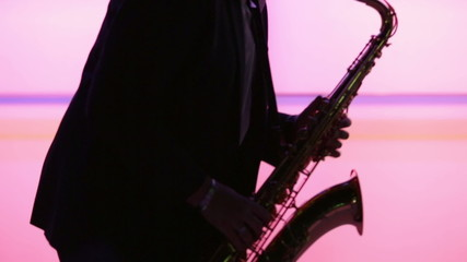 Man playing sax while making smooth dance moves
