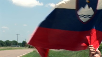 Slovenian flag undulating in the wind. Longest bicycle competition over United States of America - RAAM in 2009.