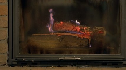 A pile of logs in front of a fireplace