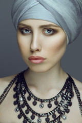 Emotive portrait of a fashionable model in turban and natural ma
