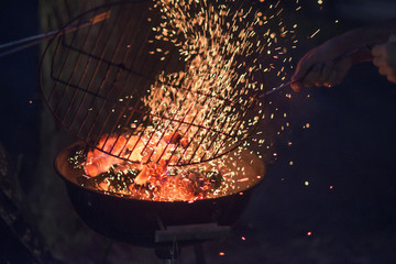 Coals and flames of a barbacue for background use